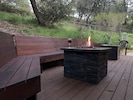 reverse shot- fire pit and seating on back deck