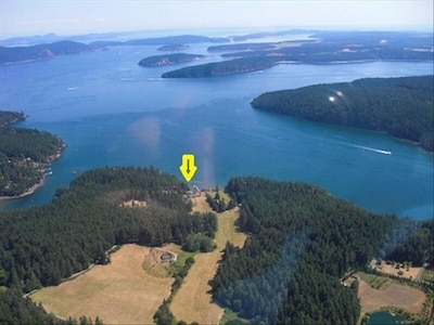 Aerial photo of the Cottage at water's edge looking south