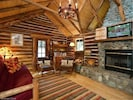 Living Room with the 22 Ft Rock Fireplace. Original Walls and Ceiling Joists