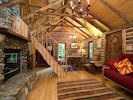 Stairs to the Sleeping Loft Carved from One Fallen Tree. Dining Table Seats 4.