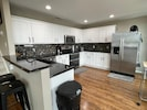 Newly remodeled kitchen with granite countertops and stainless appliances.