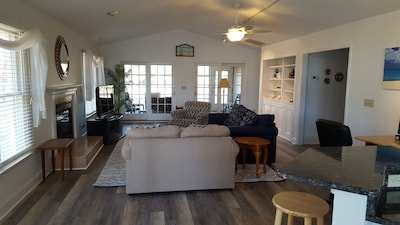 Partial view of great room from kitchen, with screened-in porch in background