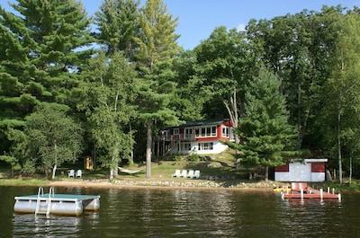 Eagle Pines Cabin on Dam Lake. Sandy beach, swim raft, kayaks, SUPs & paddleboat