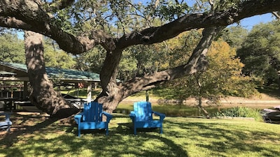 Sit down by the water's edge and relax under the shade of the Live Oaks