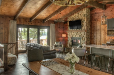 Open concept main level with walk out to deck and incredible panoramic lake view
