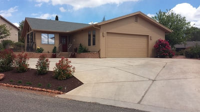 Charming single story home with oversized two car garage with views & privacy.
