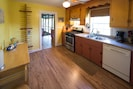 Lodge kitchen, fully stocked with gas stove, microwave, dishwasher.