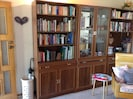 Wall unit with assortment of books for guest use
