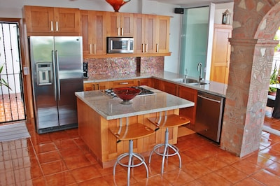 Kitchen w/all the utensils, pots, and pans you would ever need.