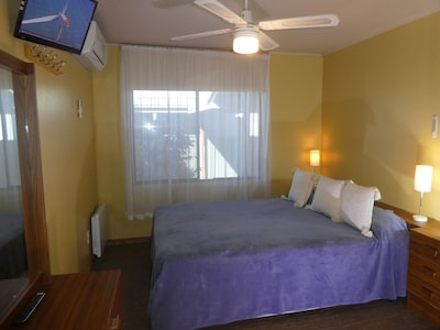 Main Bedroom pocket spring Queen, split system, TV,  dressing table, hair dryer