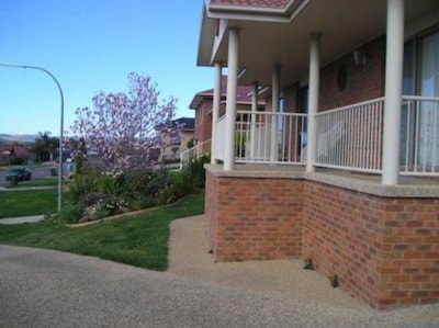 Villa 1, has  Balcony with the Hill Views overlooking   beautiful Cottage garden
