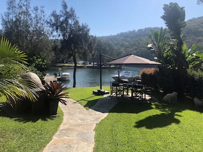 Unique Gorgeous Waterfront property on Pittwater with Jetty and flat back yard