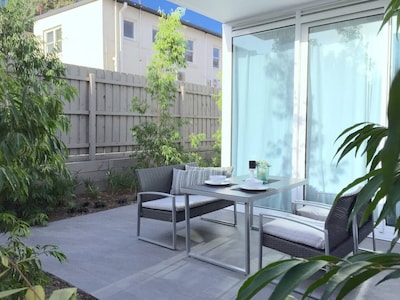 outdorr furniture and dining area in the garden