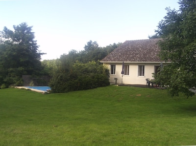 The backside of the L'Ocee holiday villa with garden, terrace, BBQ and pool