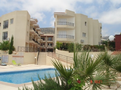Poolside view of Peyia Cottages Complex