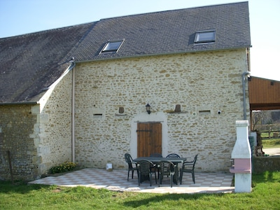 Rear view Old Stable Gite showing private patio with BBQ and table/chairs
