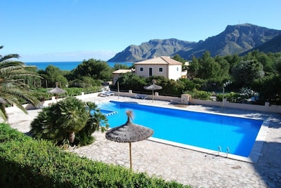 View from the house of the swimming pool and the sea and mountains