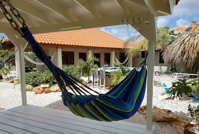 View of the studios from 1 of the  gazebo hammocks. One minute from the beach.