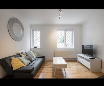 Spacious & bright living room with plasma TV sofa bed, & separate dining area!
