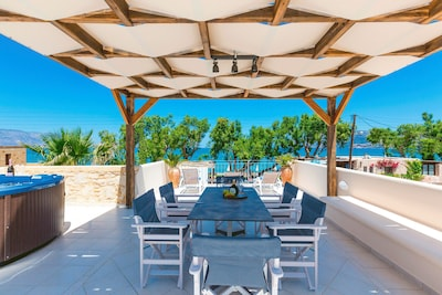 Shaded wooden roof dining area with sea view