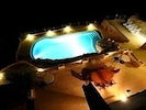 terrace and swimming pool at night