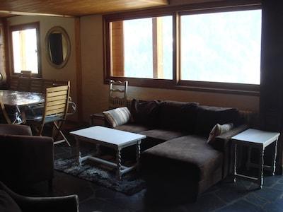 baie vitrée courantes entre le salon et la salle à manger