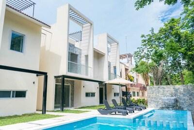 Bellos departamentos cerca de la playa en  Baru Luxury Homes Puerto Aventuras