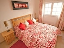 Vibrant, fun bedroom with luxurious king size bed
