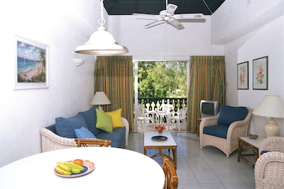 Living area with ceiling and standing fan