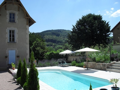 Swimming pool with terrace and view on the mountains and valley