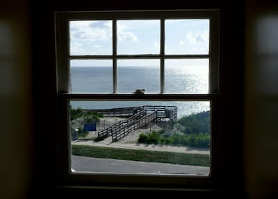 Wonderful bay views from every room. Beach access steps away!