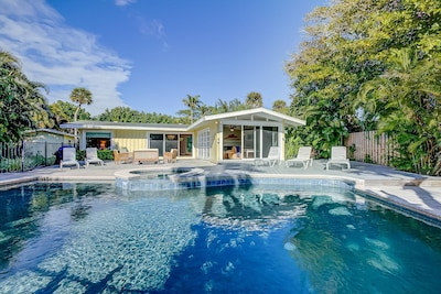 Large back paver patio with a heat optional saltwater swimming pool. Plenty of loungers and seating for the whole gang.