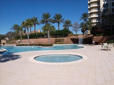 Private 4000 square foot pool with a separate children's pool and hot tub.