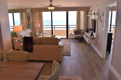 Living room and dining room looking at the ocean