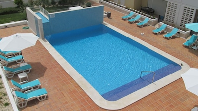 View of pool area from the balcony