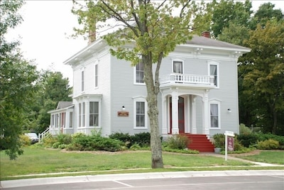 Historic home in the Village of Elk Rapids, on the corner of Ash & River streets