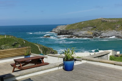 Surfside superb beach front home above Porth Beach- pets welcome