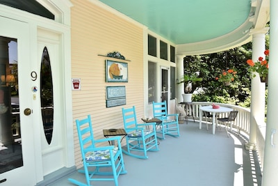 """""""Sea Gates"""" large front porch where you can relax and enjoy Bay Breezes"""