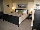 BEAUTIFUL MASTER SUITE IS LARGE WITH LOCAL ARTWORK.