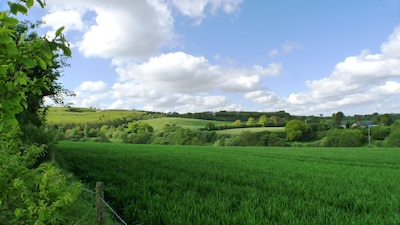 View from the garden over the valley. Surrounded by arable fields