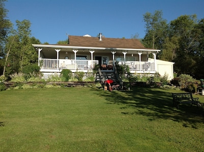 Relaxing 3 acre property on the Ottawa River.  5 bedroom