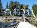 View of condo building from dock - Unit 101/201 is on the far left