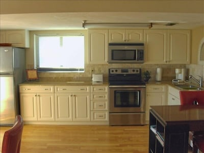 Fully equipped Kitchen has corian counters, disposal, new appliances & icemaker