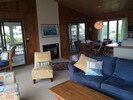 Living room looking NE to dining area. (Screened porch beyond sliding doors.)