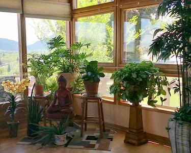 This is a view in the south end of the great room. We collect Buddha statues.