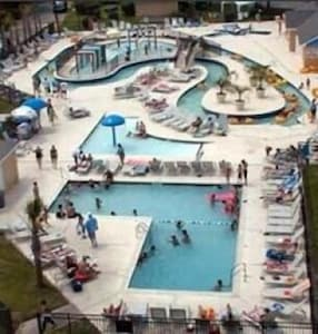 Enjoy our Lazy River, Kiddie Pool & Adult Pool