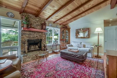 Living Room with wood burning fireplace.