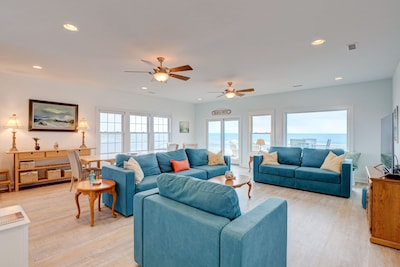 Top Level- Family Room - open concept & wall to wall windows of the ocean