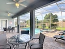 Outdoor living area-perfect for family gatherings. Pool safety gate provided