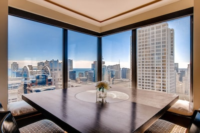 Dining area surrounded by lake and city views!